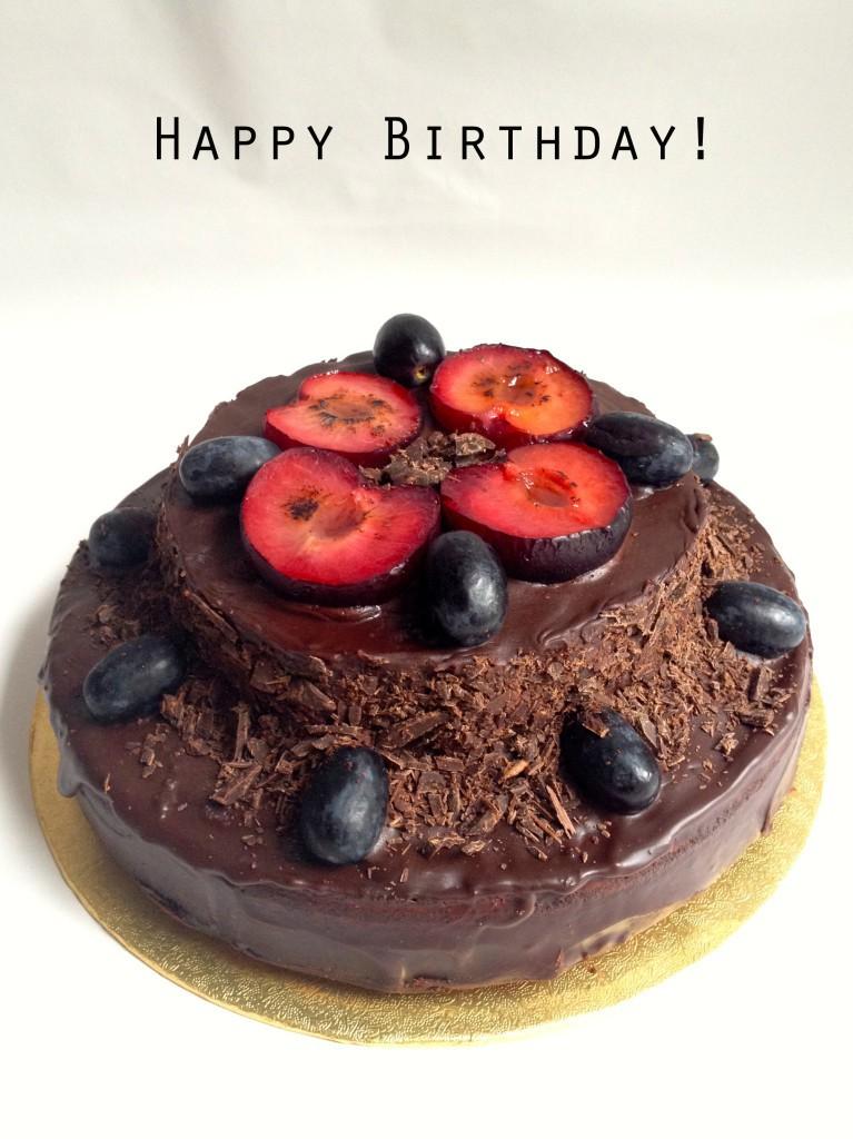 Chocolate amaretto cake decorated with sugar glazed fruits