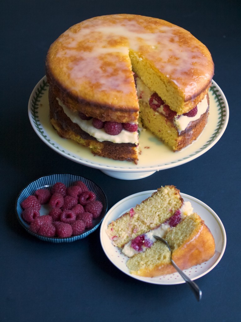 Orange and white chocolate cake with raspberries