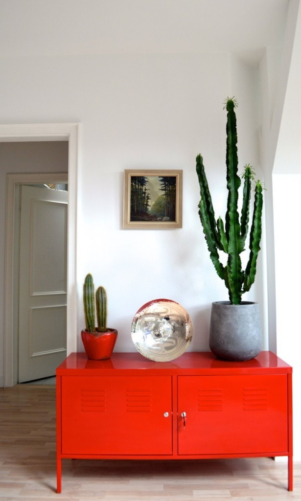 Bold red accent cabinet, pic from apartment therapy